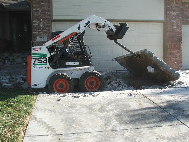 Bobcat specialties for Removing concrete walkway